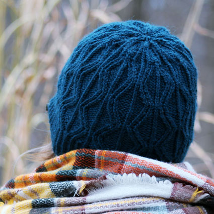 Blue hat with geometric diamond-shaped cables