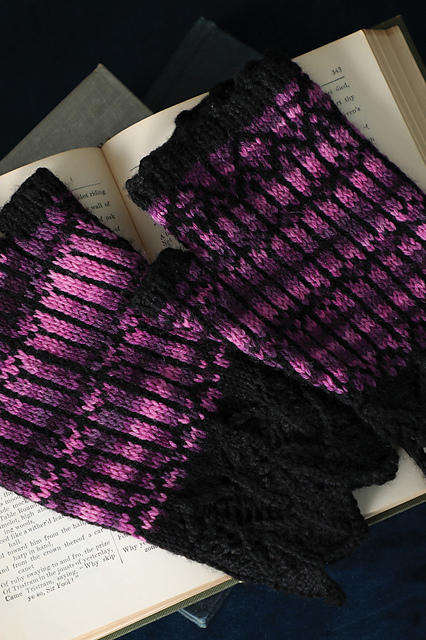 A pair of fingerless mitts laid on top of a book.